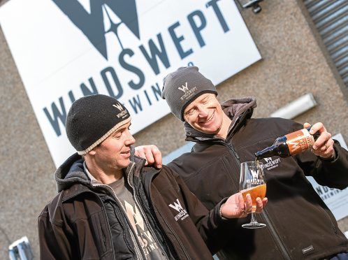 Pictured here (L-R) Al Read, Director of Operations and Nigel Tiddy, Managing Director with a glass of beer.