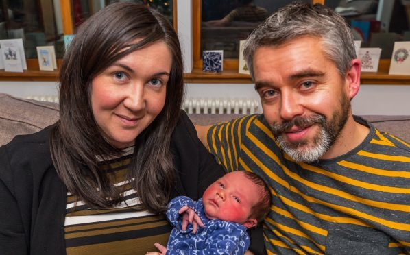 This is baby Charles with mother Elaine and father Stewart Sutherland