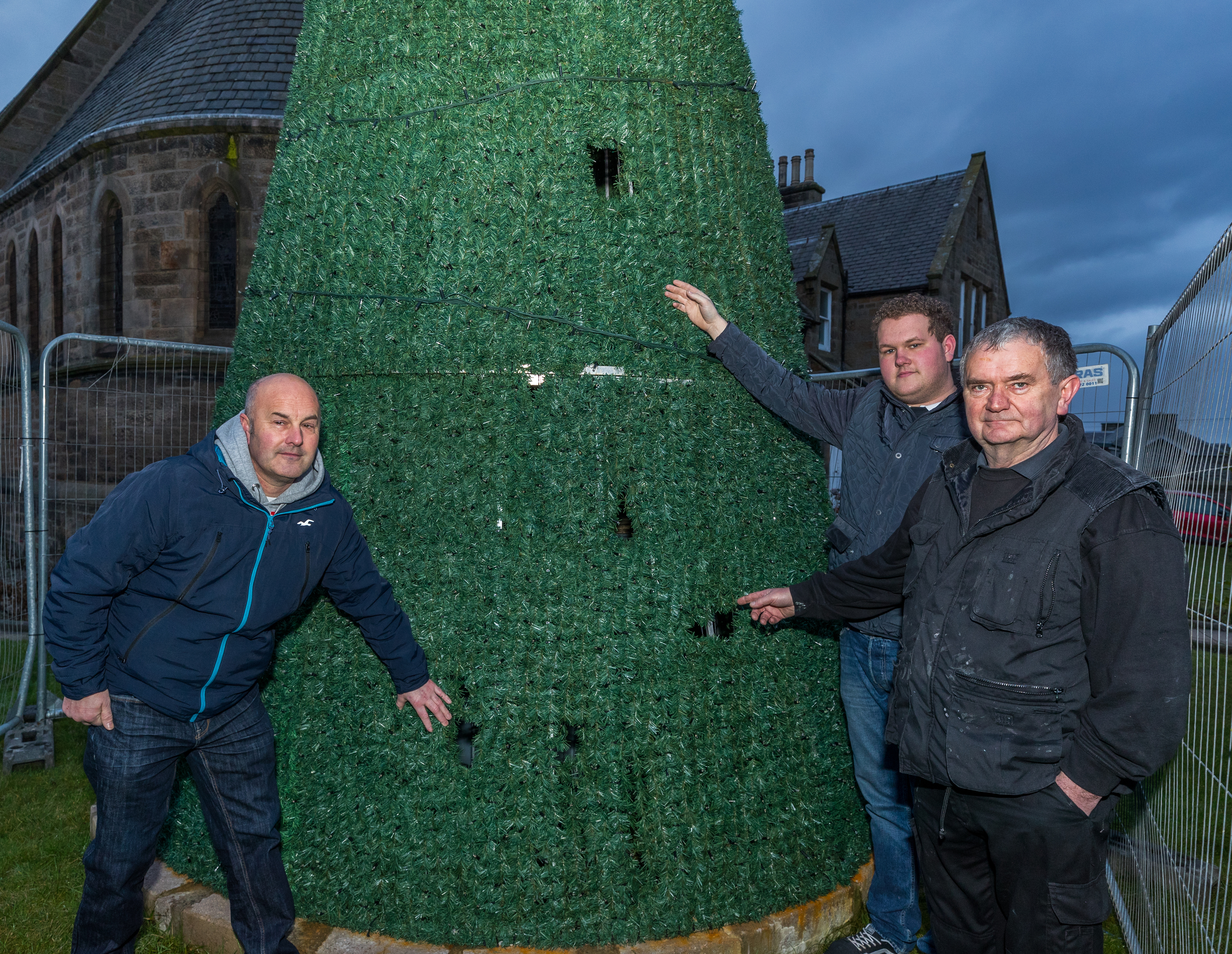 Holes have been clearly made to the structure of Buckie's Christmas tree. Pictured: Buckie Christmas Kracker chairman Andrew Murray ,Adam Murray, Alan Cruickshank.