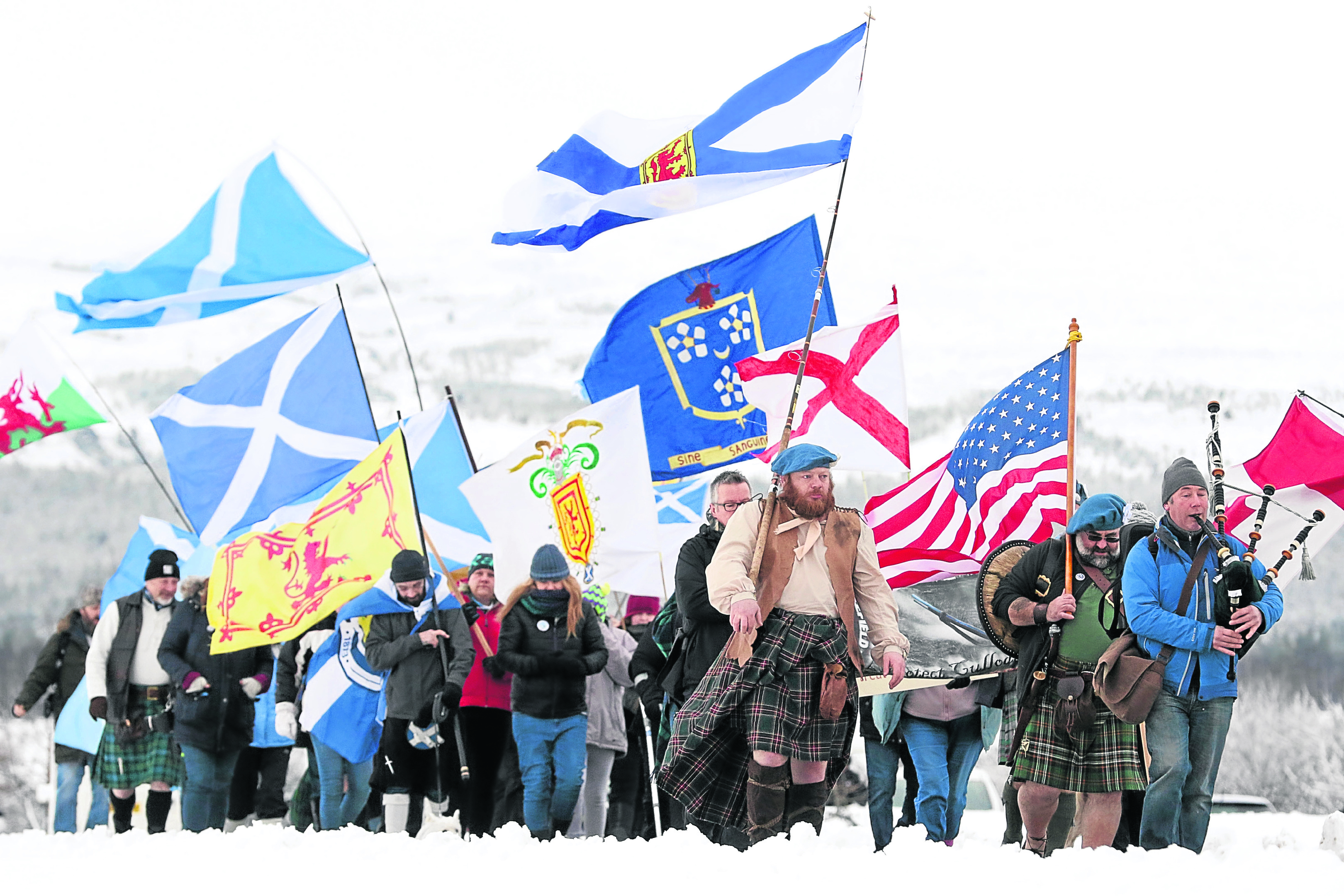 Protestors marched from Culloden Battlefield to the site of the controversial proposed housing development.