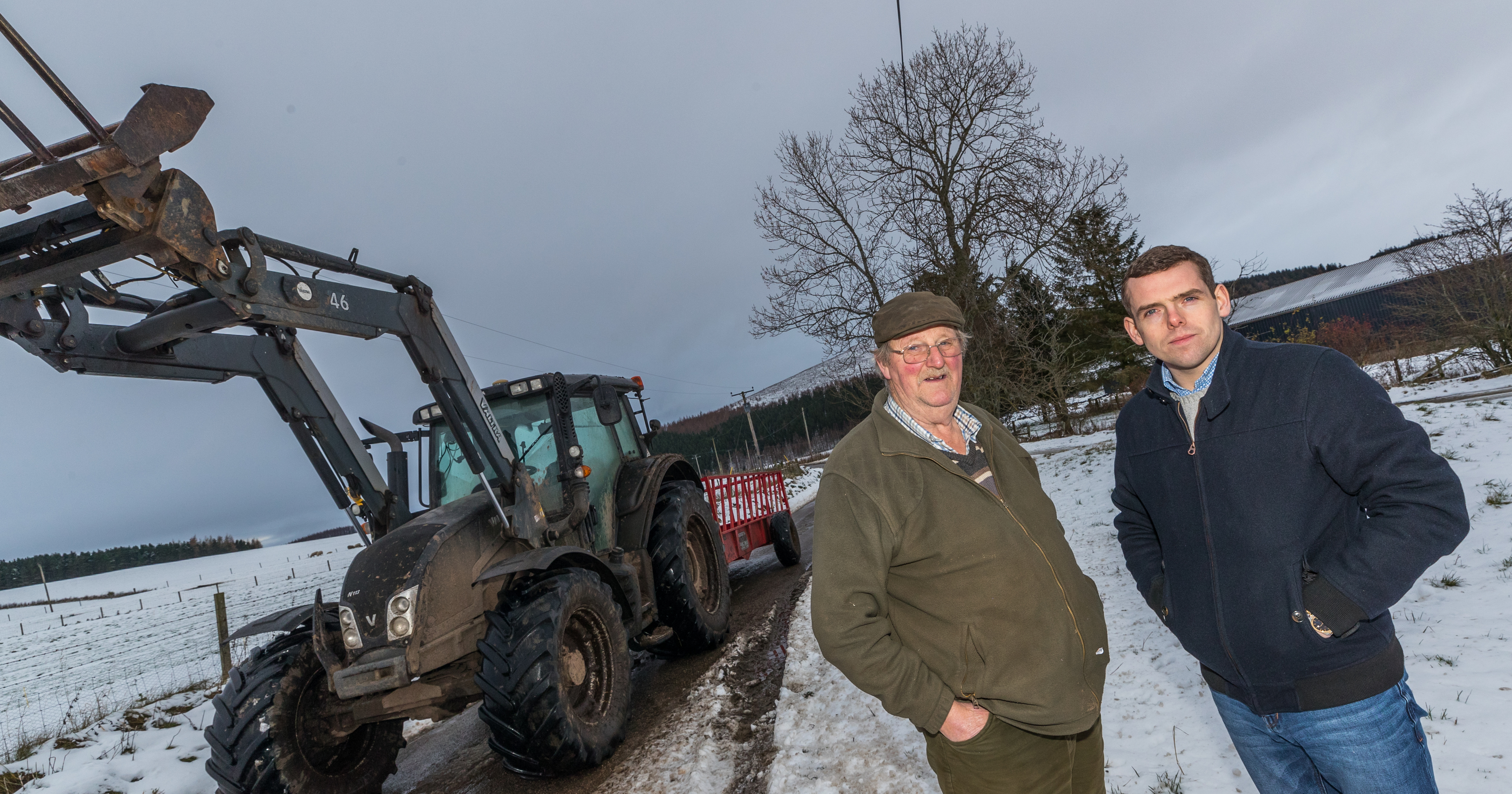 Glenlivet farmer Alastair Nairn, pictured left, fears he may have to use his tractor to help get children to school. Also pictured: Moray MP Douglas Ross.