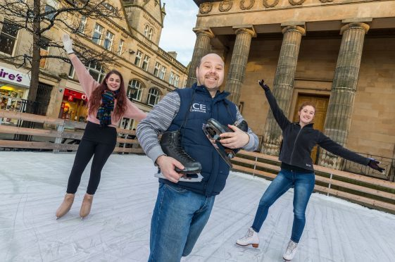 Front Jon Behari and rear L/R - Kerri Stuart and Amber Kenny on the Ice in the High Street outside St Giles, Elgin