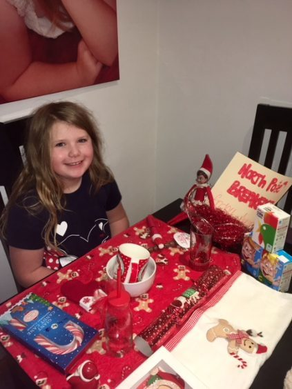 Ayiana Stewart (age 8) with her elf Sparkle who made her a North Pole breakfast