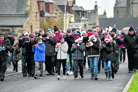 The flute band leads the annual Christmas Day walk