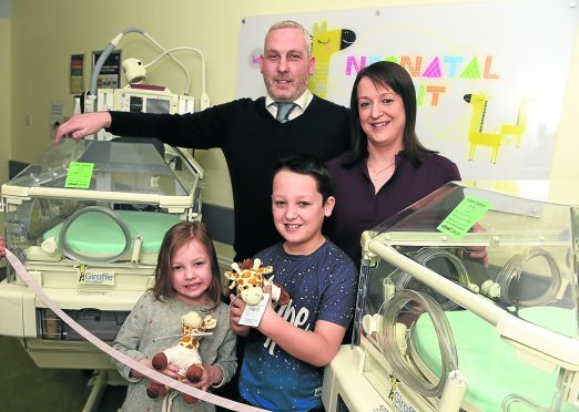 Pictured from left, Graham Wood, wife Gillian Wood and their children, Jack, 8 and Ellie, 7.