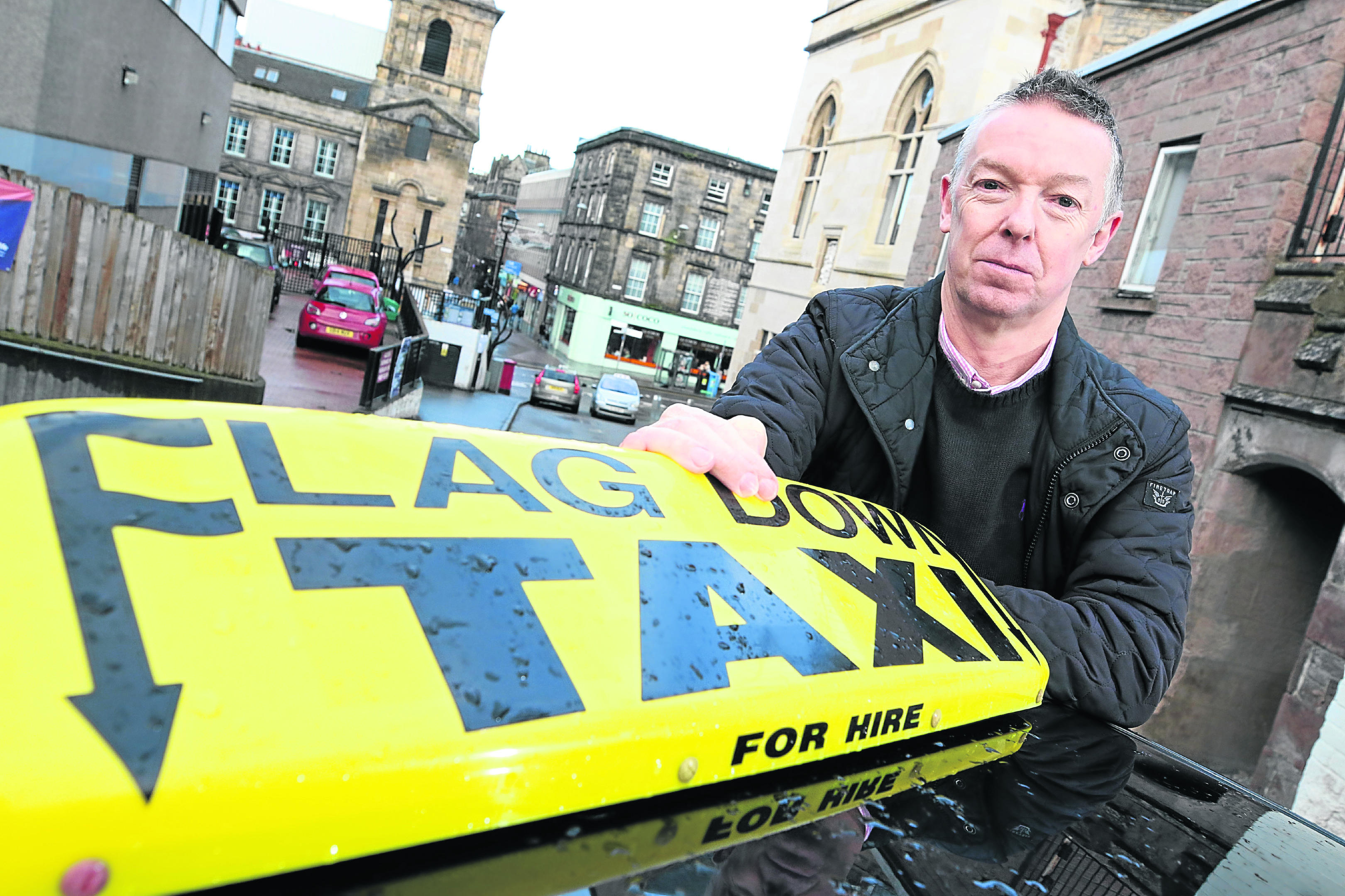 Inverness taxi driver David Coutts at the Castle Wynd rank.