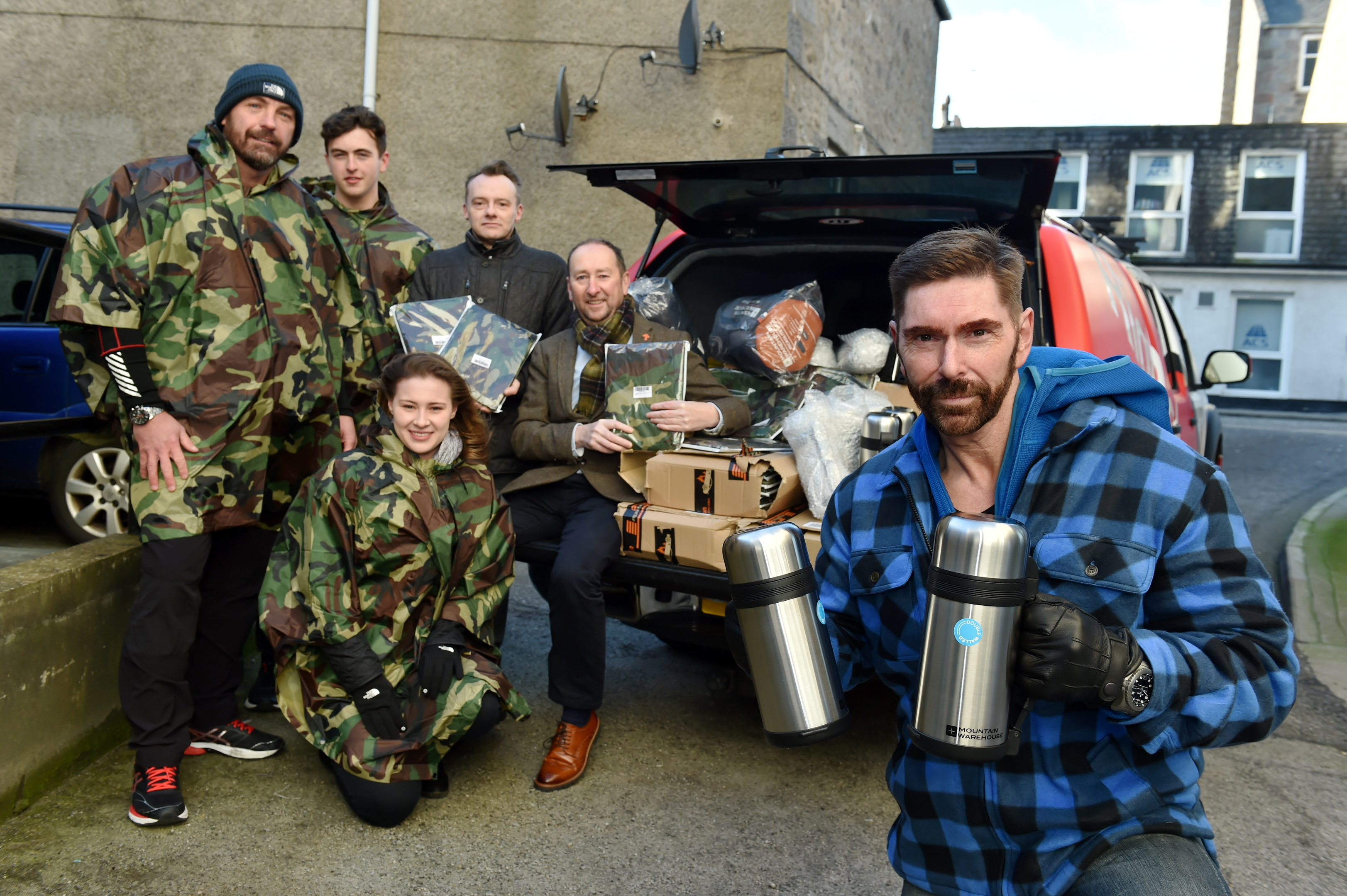 Ian Garden donated 100 blankets and thermal flasks to Social bite and the Cyrenians so they can distribute them to Aberdeen's homeless community. Picture of (L-R) Michael Byrne, Laim Byrne, Natasha Watt, Matthew Thomas, Mike Burns (Cyrenians) and Ian Garden.  Picture by KENNY ELRICK     07/12/2017