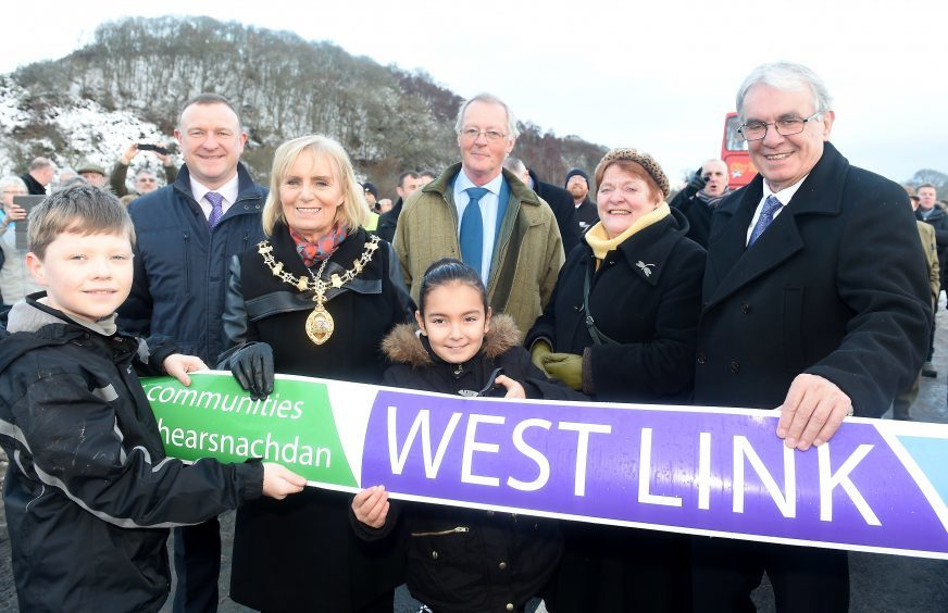 Provost Helen Carmichael of Inverenss assisted by pupils Roddy McLennan of Kinmylies Primary School and Kelsey Campbell of Holm Primary School perform the official cutting of the ribbon. Picture by Sandy McCook.