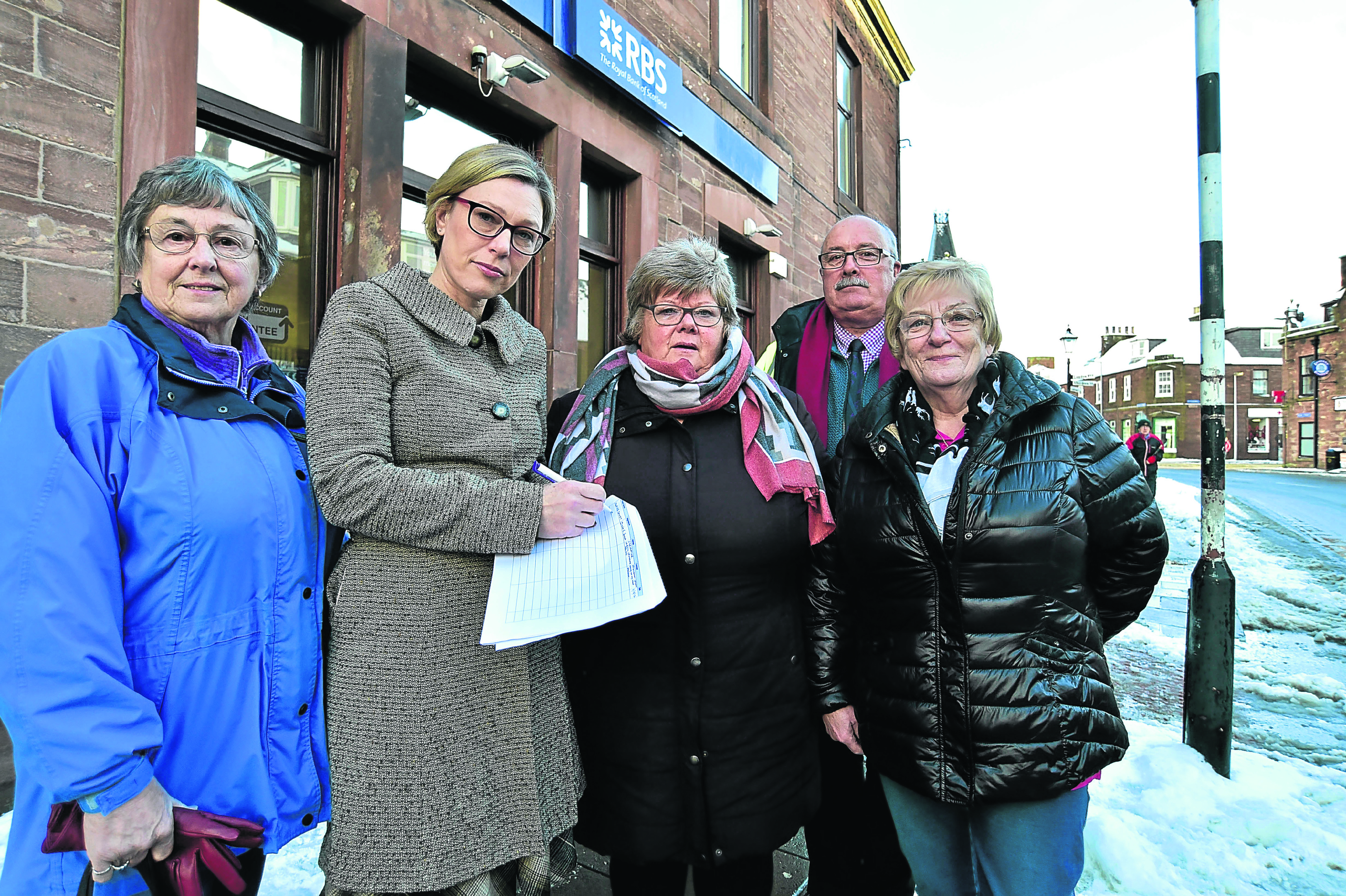 MSP GILLIAN MARTIN SIGNS A PETITION TO KEEP THE RBS BRANCH IN TURRIFF OPEN WITH (L TO R) ANNETTE STEPHEN, COMMUNITY COUNCIL, MARGE CHALMERS, TURRIFF AND DISTRICT BUSINESS ASSOCIATION CHAIR, CLLR ALASTAIR FORSYTH AND COMMUNITY COUNCILLOR ROSE LOGAN.
