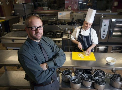Alistair Fowlie, pictured left, assistant director of hospitality at Moray College UHI, has helped to set up an initiative to tackle the lack of staff in the sector. Also pictured: lecturer Craig Wilson.