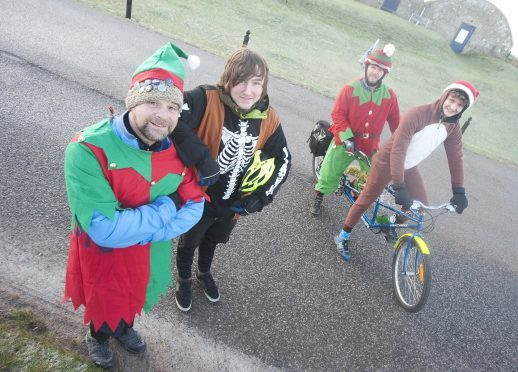 Outfit Moray ran a tandem around the new NE250 route to raise money to stop the charity folding.  Pictured: Stewart Evans, Wayne Reid , Chris McCann and David Brackpool.       Photo by Michael Traill