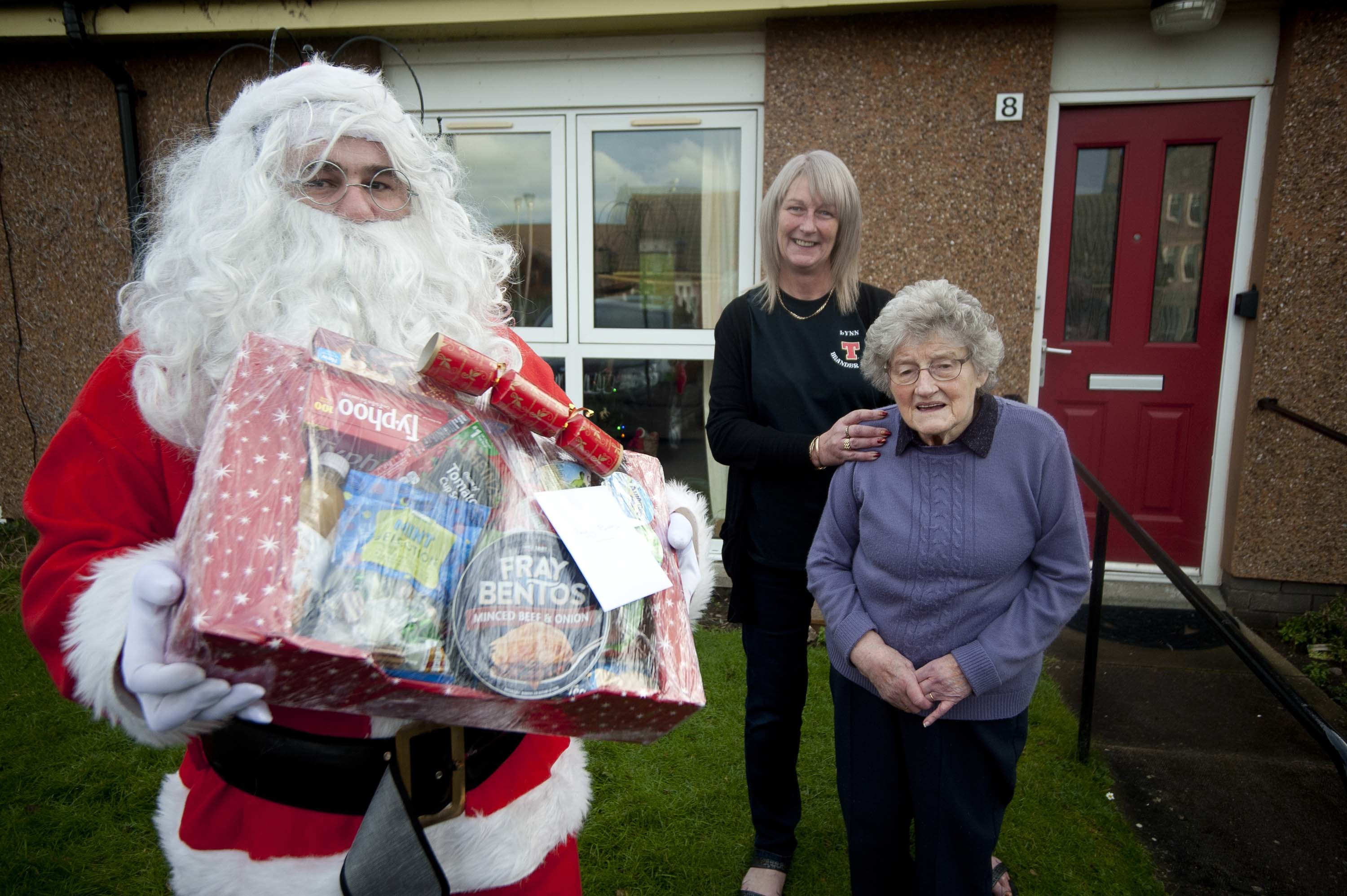 The Brander Arms in Lossiemouth has delivered more than 80 food parcels to pensioners in the town. Pictured, from left: Ryan Edwards, landlady Lynn Mitchell, Helen Edwards.