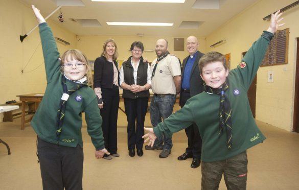 In photo from the left, Linda Brown head teacher at lossiemouth High school,  Eliz Munro,  Allan Anderson group scout leader and  Rev Geoff Mckee minister of St Gerardines High . Also in the photo at the front Emily Rose findlay 8 and Jamie Read 8