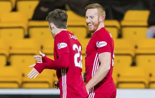 Adam Rooney was in clinical form for Aberdeen against Ross County.