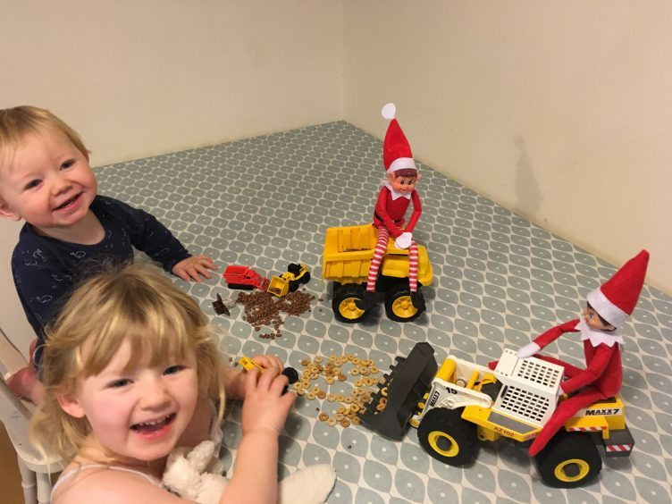 These elves have been getting up to mischief entertaining Katie (4) and Struan (1 1/2) on Mull! This morning they were caught using toy diggers to shift the breakfast cereals around the table!