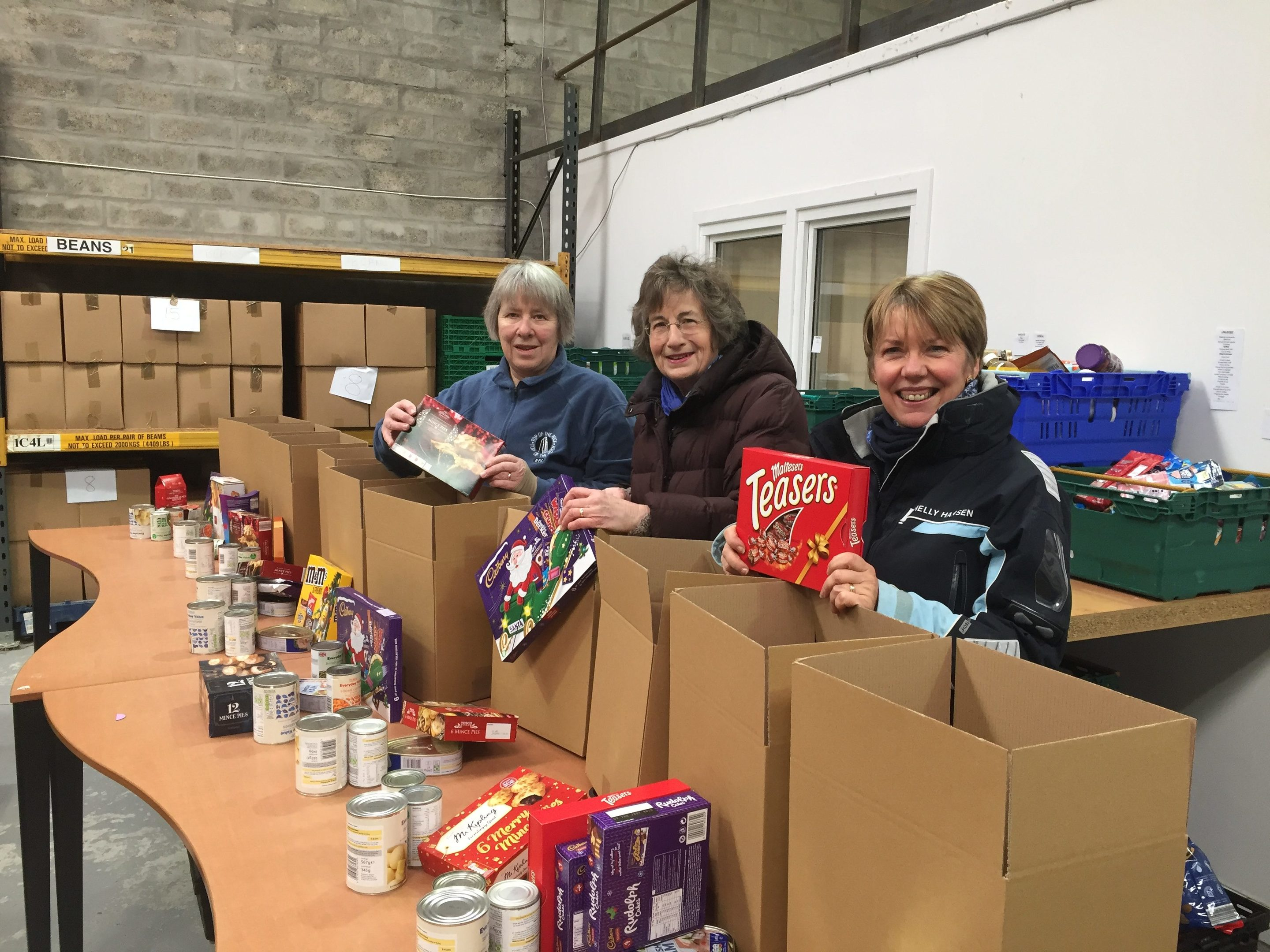 (L-R) Foodbank volunteers Marbeth Ritchie, Marty Donaldson and North Aberdeenshire Food Bank manager Jeannie Price pack up Christmas hampers.