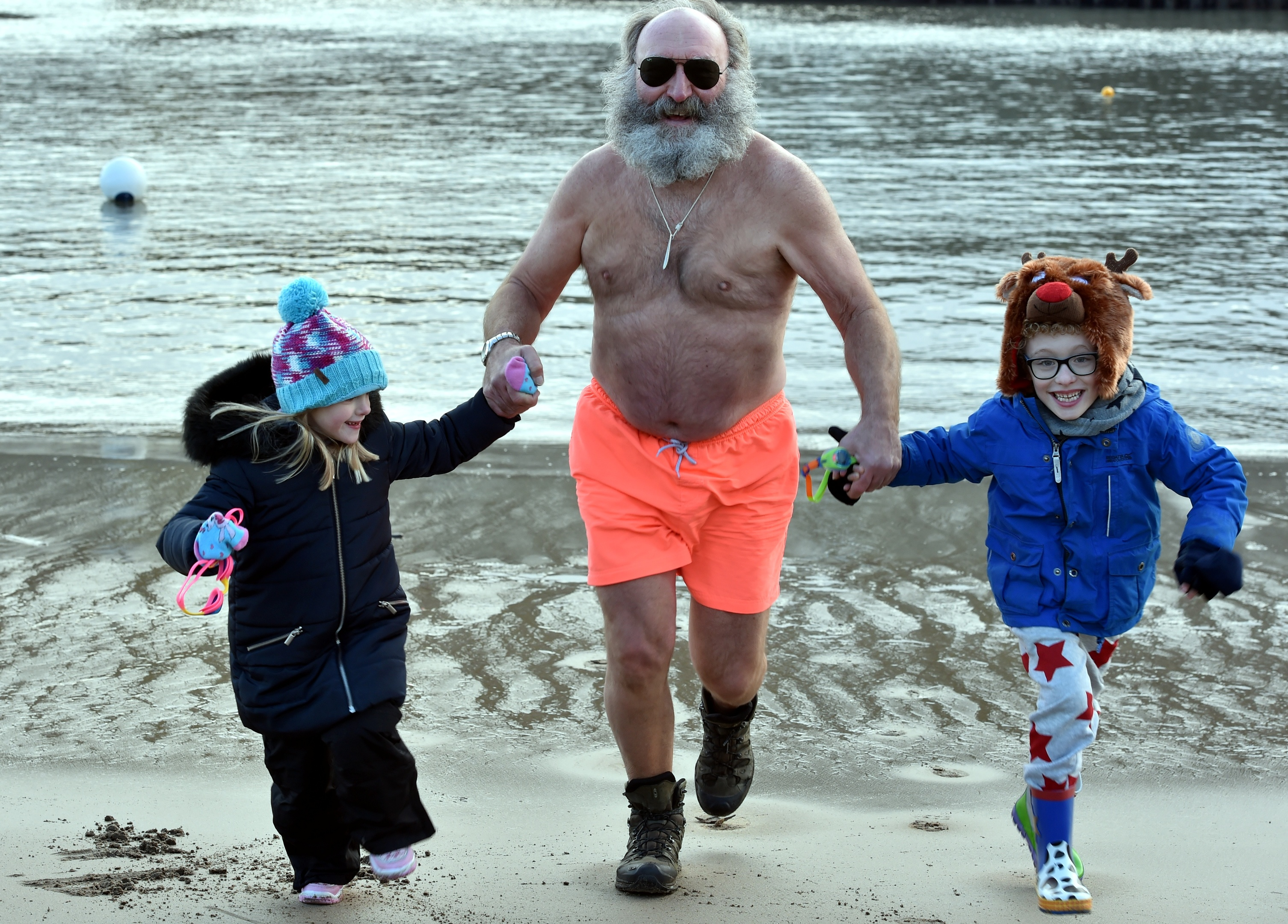 Phil Mills Bishop is with Isla Wilson, 7 and Kai Cox, 7. Picture by Colin Rennie.
