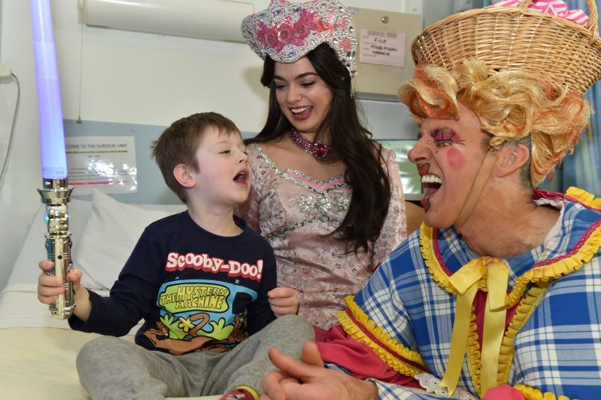 Filip , 5 with  (from left) Lisa-Anne Wood (Princess Jasmine) and Alan McHugh (Widow Twankey).
