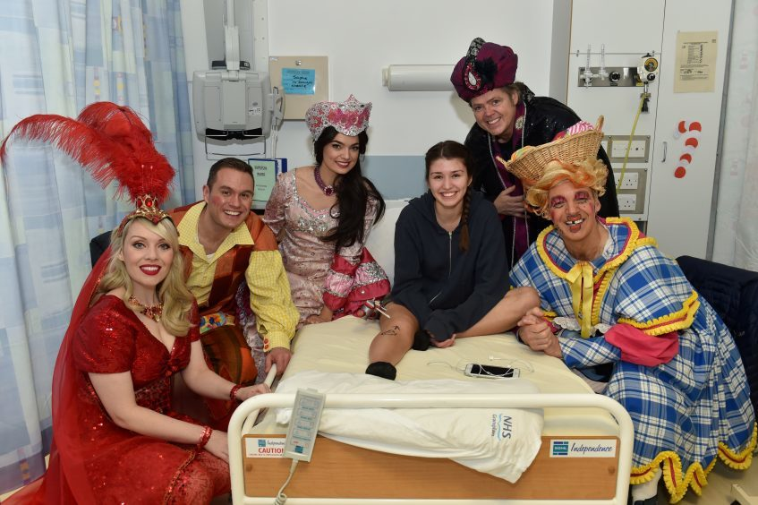 Eighteen year old Sophie Hanneman with cast  Nicola Jane Meehan (Scheherazade), Jordan Young (Aladin), Lisa-Anne Wood (Princess Jasmine) Jimmy Osmond (Abanazar) and Alan McHugh (Widow Twankey).