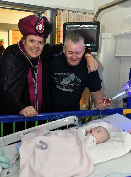 Jimmy Osmond (Abanazar) with James Barrett and Mayas Marie (7 months).