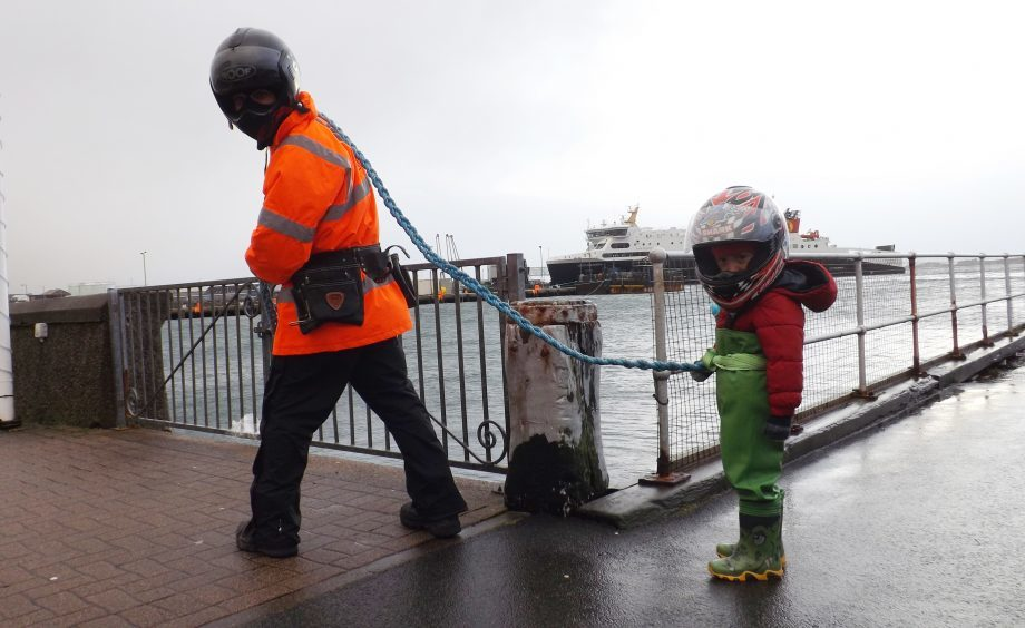 FISHERMAN VOJTA VESZPREMI AND HIS FOUR YEAR OLD SON TOBIAS WHO LIVES IN STORNOWAY
