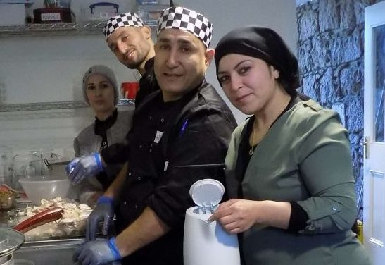 Sam and Adel in the kitchen aided by their wives, Sabaa and Khaja