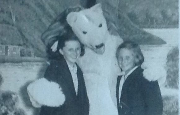Childhood friends Wilma and Cora pictured with a bear, in 1951