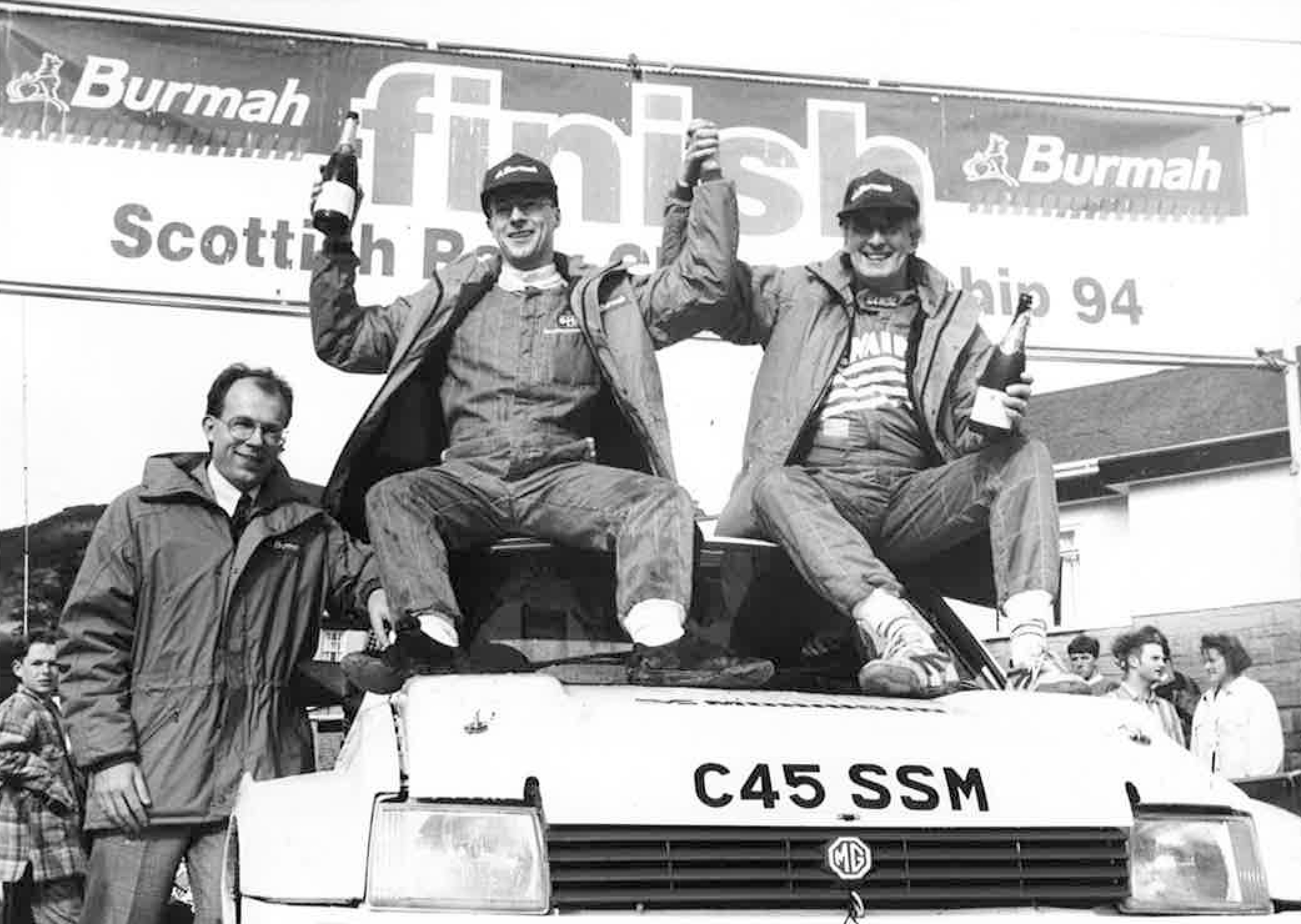 Donald Milne (middle) and Bob Wilson (right) with the Burmah petroleum Marketing Director, Richard Miles (left) after winning the 1994 Burmah Scottish Rally Championship.