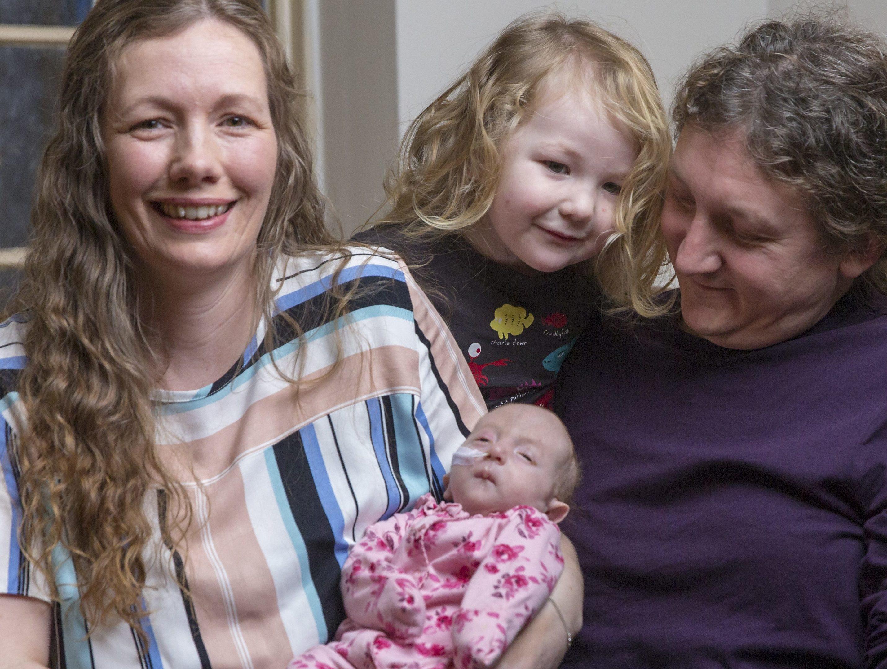 David and Gina Scanlan, Jude Scanlan, 3, and Willow Scanlan pictured at 9 weeks old