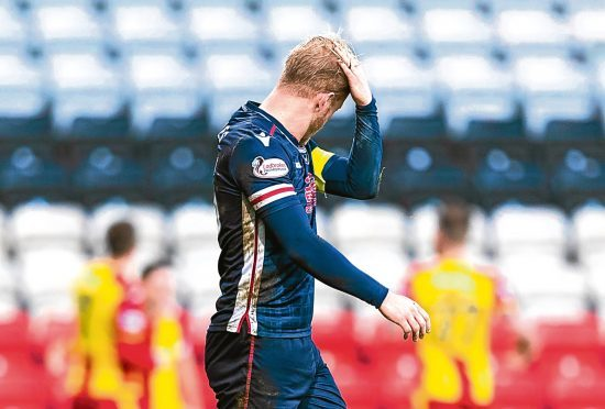 Dejection for Ross County's Andrew Davies