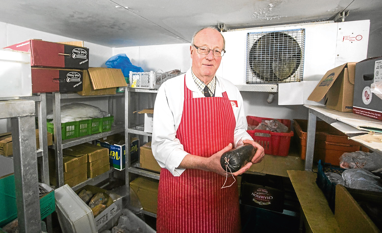 Christopher McGabe at his butchers shop in Totnes, Devon.