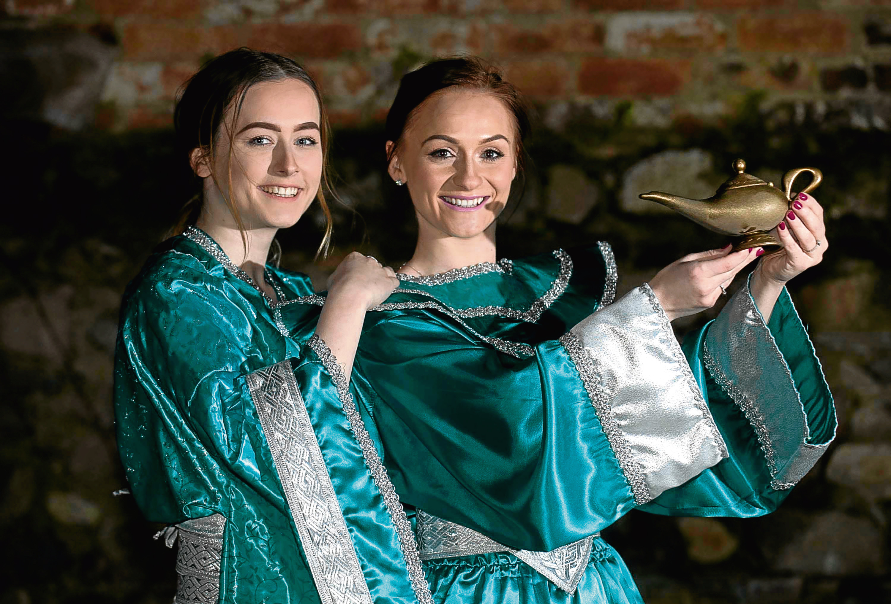 Photo of the Buckie Community Theatre dress rehearsal for the panto, Aladdin. It could be their last at the Fishermans Hall in Buckie, which the council wants to shut.  In photo  from the left Princess Lotus Blossom played by Amy Lewis 18 and Aladdin played by Vicki Donn, 24.