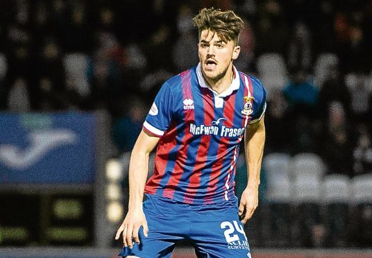 Charlie Trafford in action for Inverness.