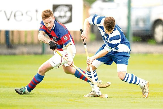 Fraser Munro (Kingussie) and Drew Macdonald (Newtonmore).  in action