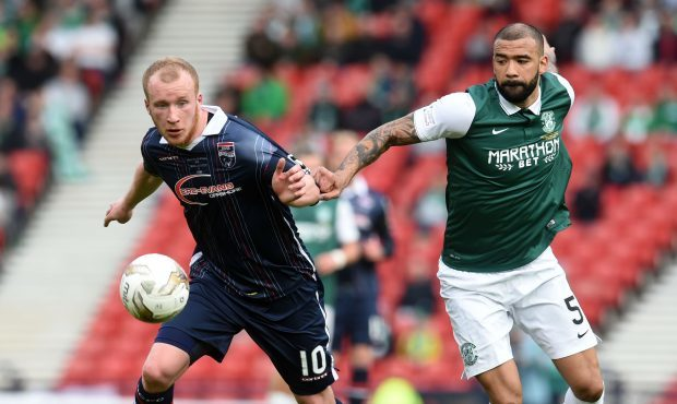 Hibernian's Liam Fontaine in action against ex-Ross County striker Liam Boyce in 2016