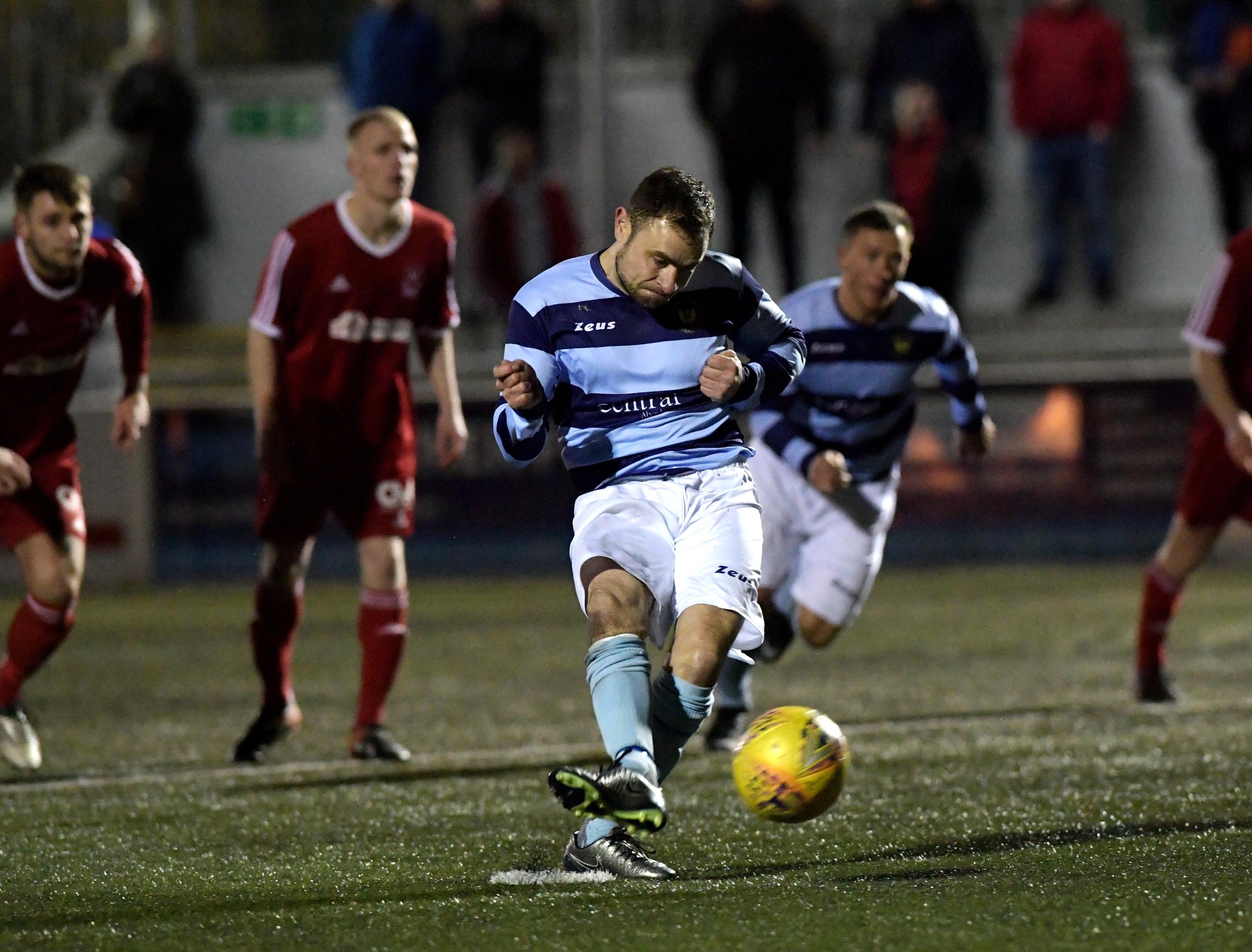 Dee's Jamie Watt scores from the penalty spot.