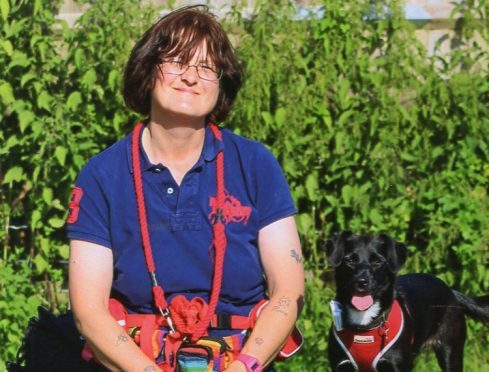 Missing woman Helen Slaughter with her dog Ethel