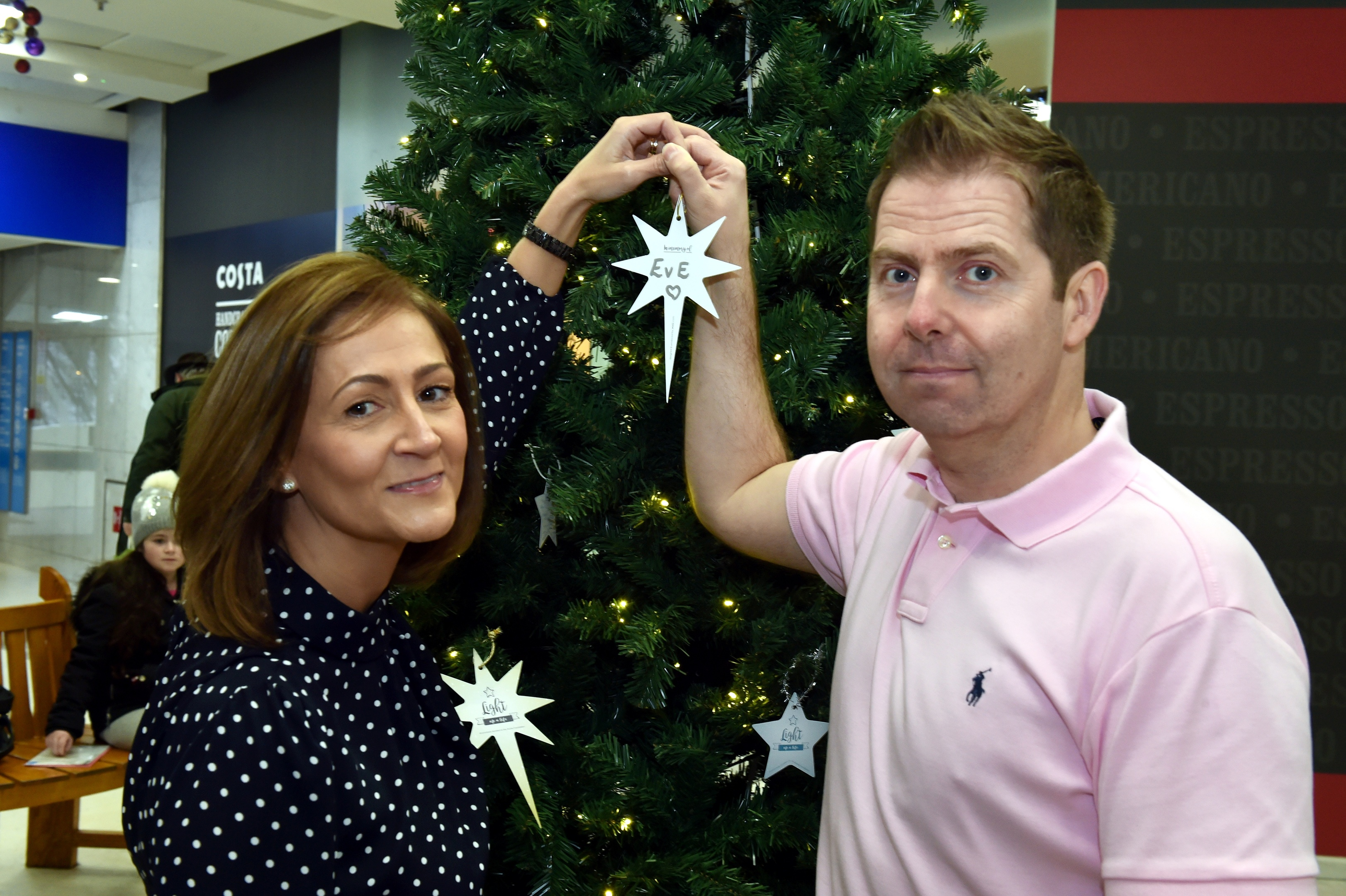 Louise Park and her partner Gary Hayes set up a special Christmas memory tree with funds going towards the ARCHIE foundation. Picture by Colin Rennie.