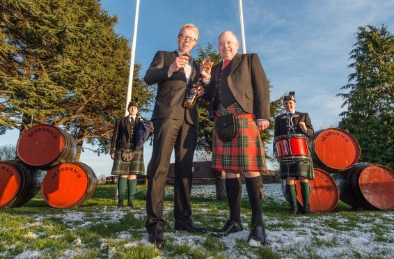 The new Chieftan of piping at Forres, Mr Alan James pictured at Ben Romach Distillery (Right) and accompanied by Ian Chapman (Left) MD of Ben Romach Distillery.