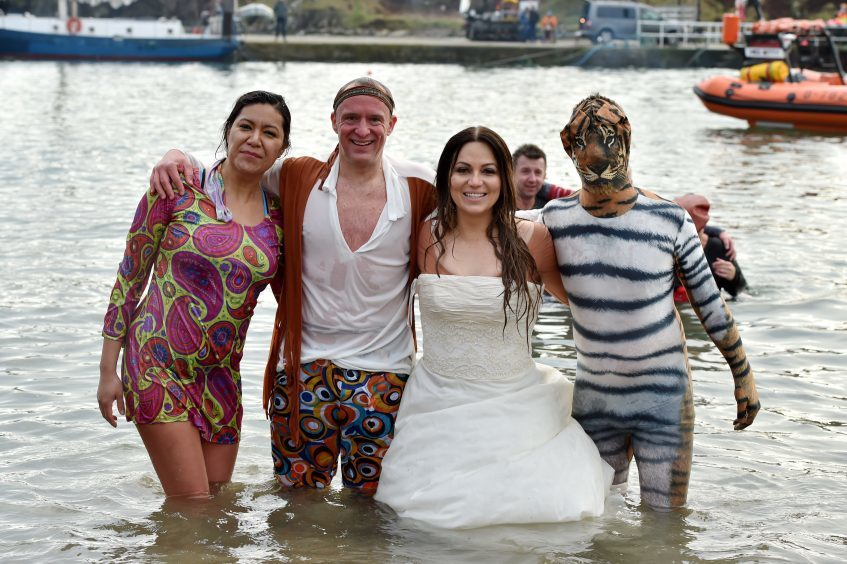 The annual New Year's Day Dip at Stonehaven.   Picture of (L-R) Katrina Vazquez, Dave Cox, Maria Glegg, Michael Hopkins.  Picture by Kenny Elrick