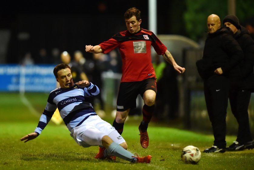 Picture of (L-R) Jack Henderson sliding in on Jordan Leyden.