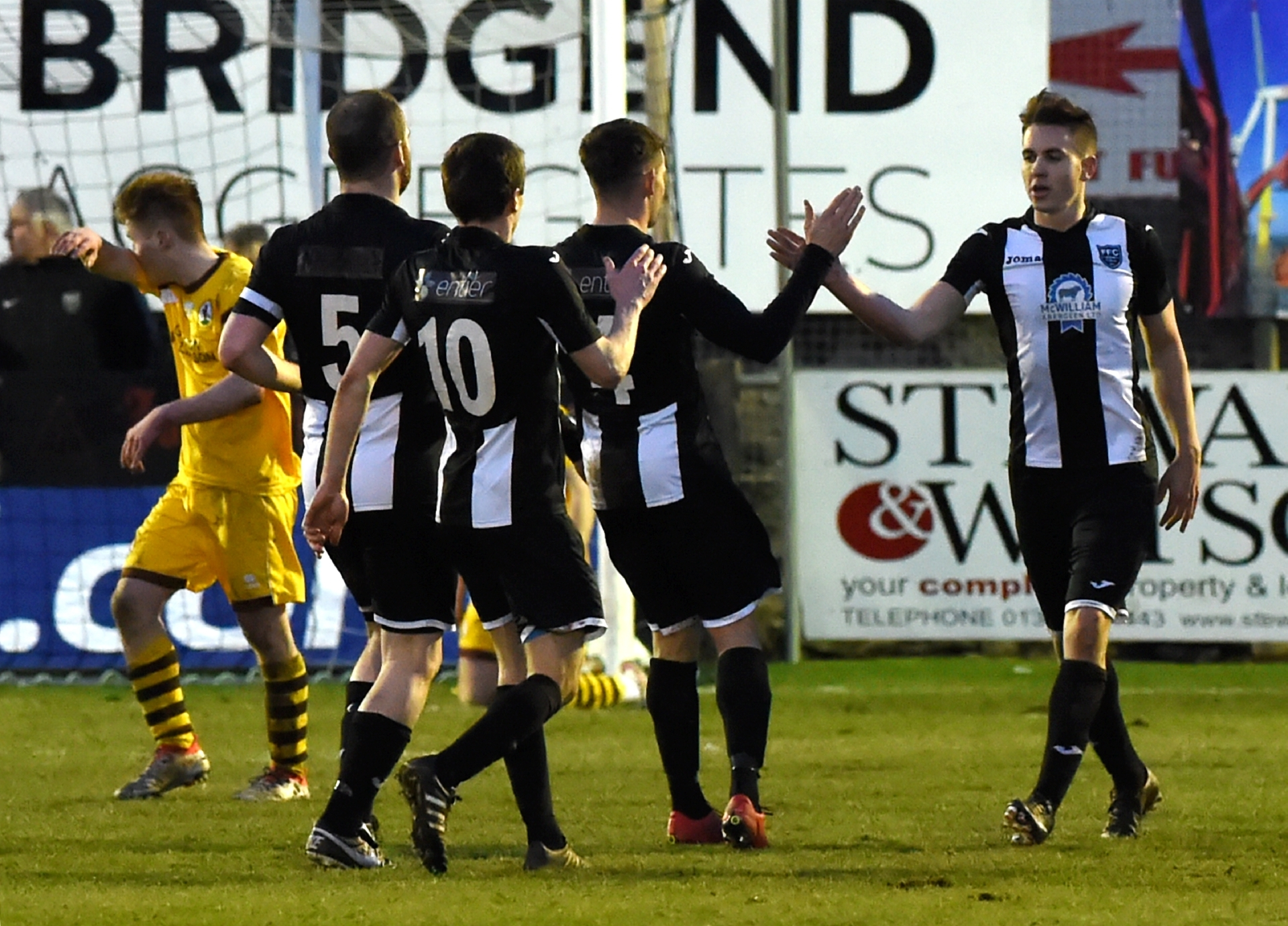 Paul Campbell celebrating with team mates after scoring to make it 5-1. Pictures by Kenny Elrick