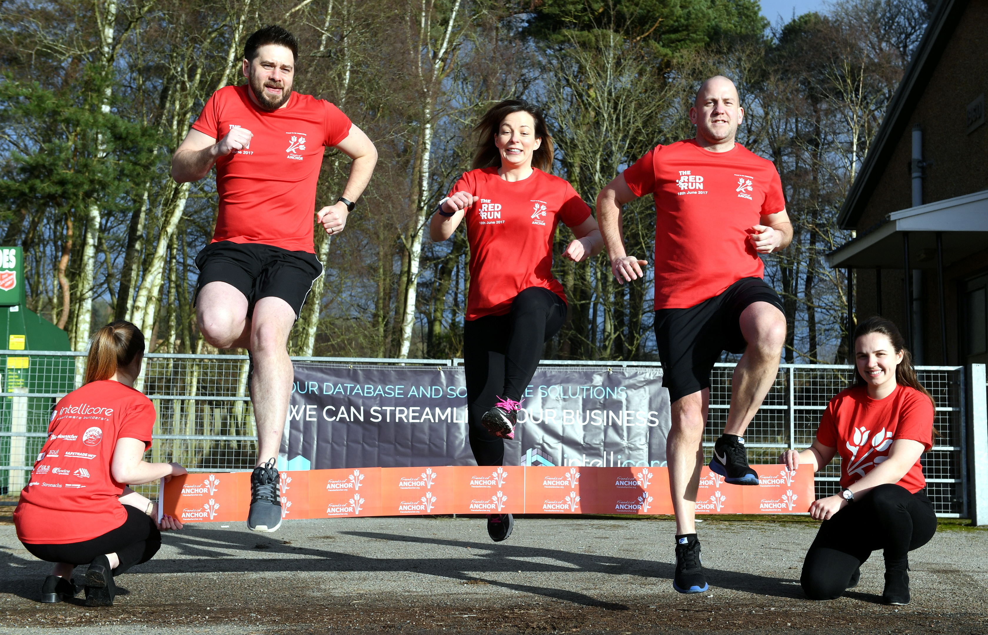 Pictured - L-R Barry Booth (Intellicore), Wendy Bridger and Michael Howden (Red Run organisers) leap over the tape with Ursula Fairlie of Friends of ANCHOR (right).      Picture by Kami Thomson
