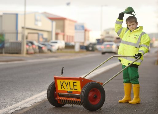 Eight year old Kyle Mackay of Kiltarlity with his new grit spreader with which he was presented in Inverness yesterday to help keep the villages pavements free of ice.