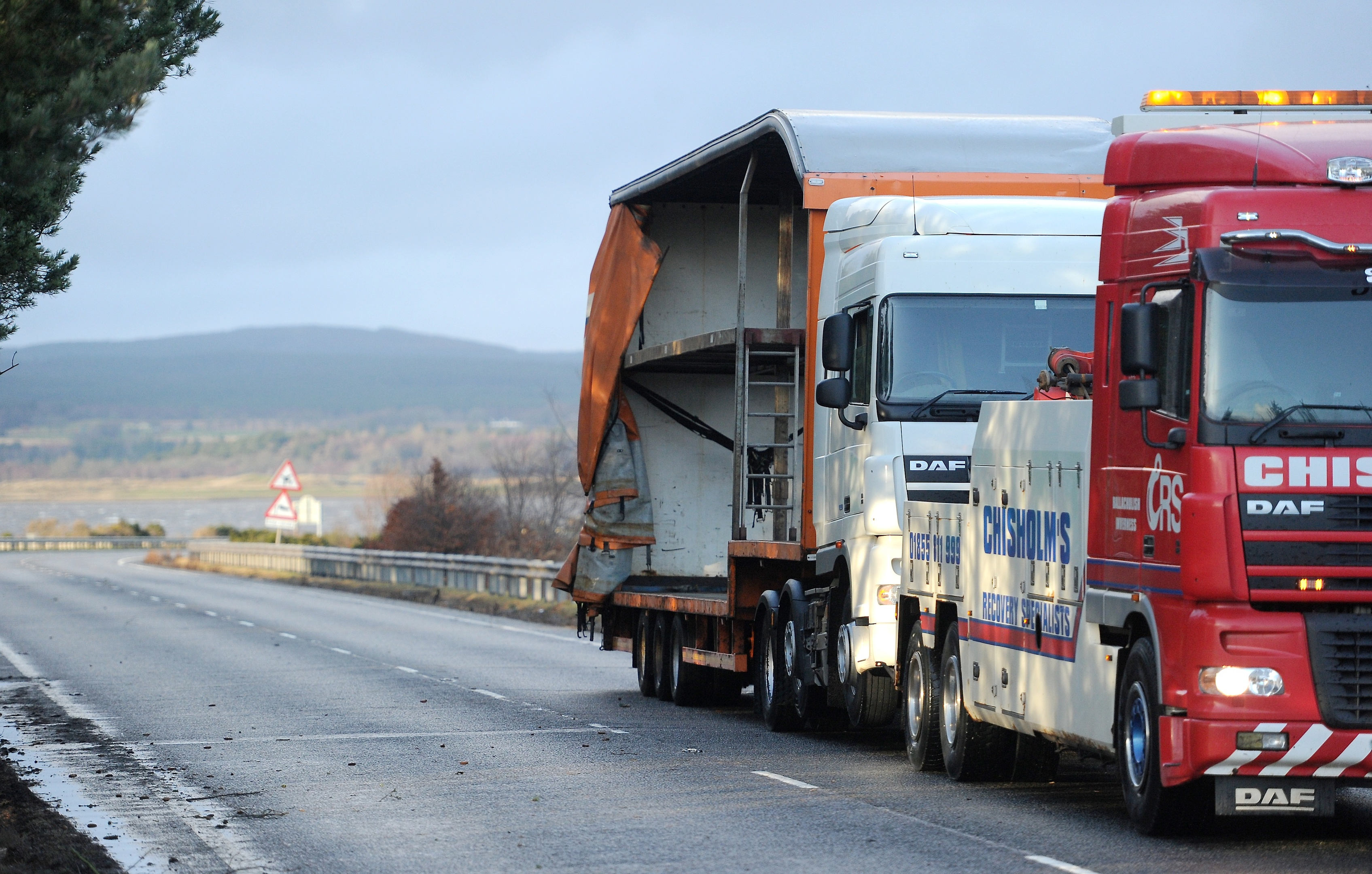 The articulated lorry is removed from the Dornoch Bridge yesterday afternoon after striking the barrier in high winds.Pic by Sandy McCook