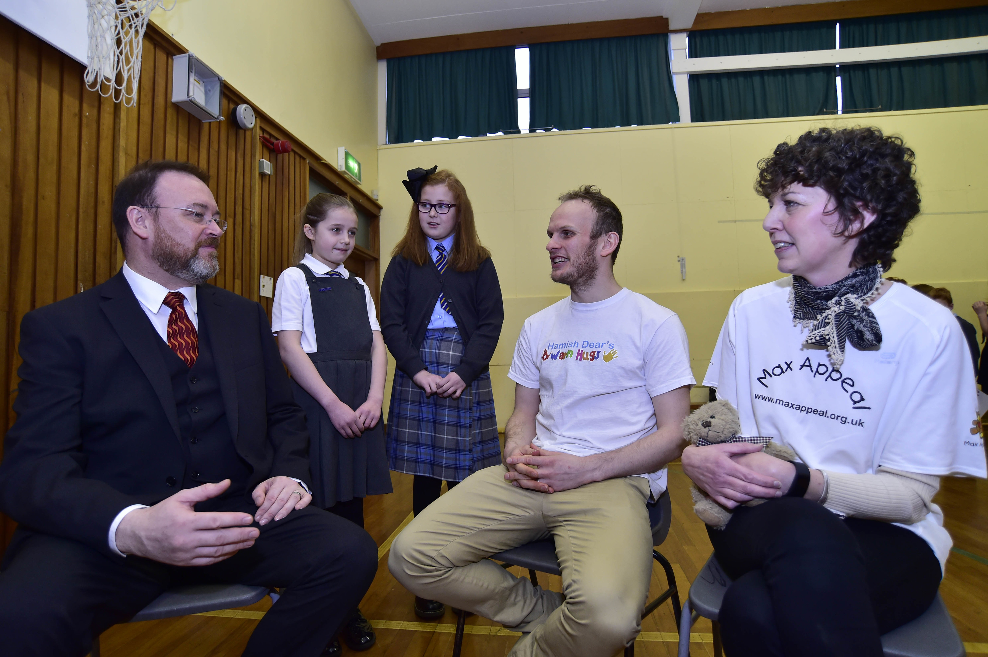David Duguid, representatives from the charities and pupils of St Fergus Primary School.