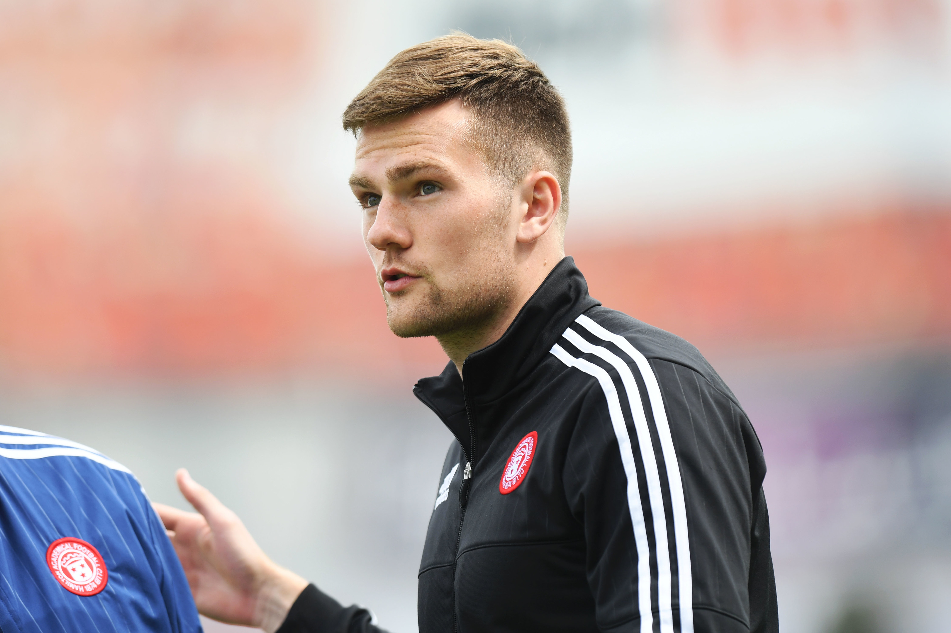 Mikey Devlin signed a three-and-a-half year deal with the Dons.