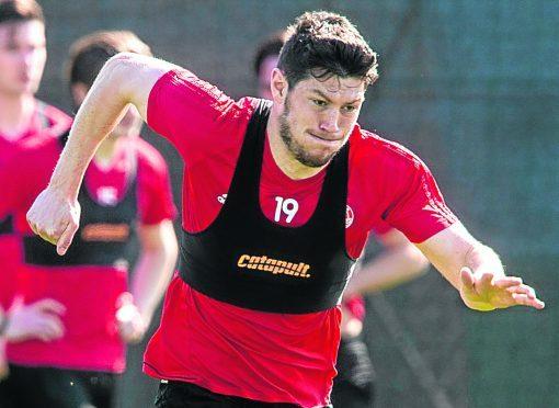 Aberdeen rejected a £3.5million bid from Celtic for Scott McKenna.