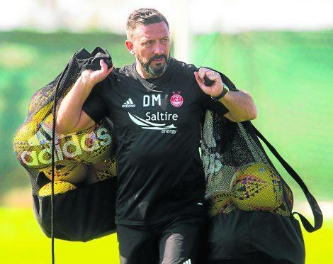 Aberdeen manager Derek McInnes at training in Dubai.