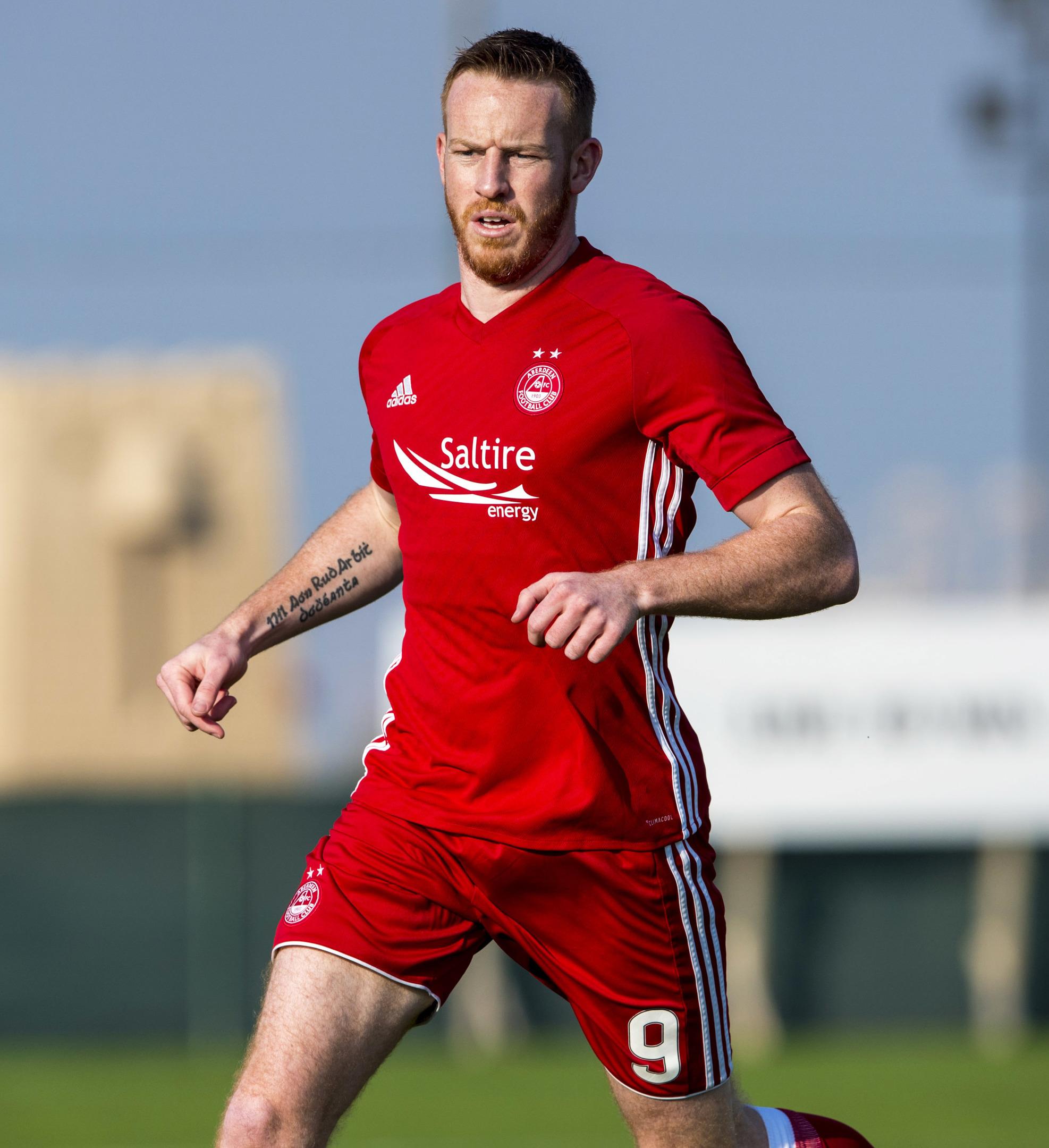 Adam Rooney left Aberdeen FC yesterday
